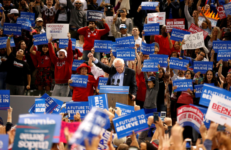 Image: U.S. Democratic presidential candidate Bernie Sanders announces to the crowd that he had just won Oregon during a rally in Carson