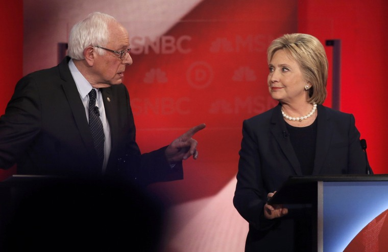 Image: Democratic U.S. presidential candidate Senator Sanders speaks directly to former Secretary of State Clinton as they discuss issues during the Democratic presidential candidates debate sponsored by MSNBC at the University of New Hampshire in Durham