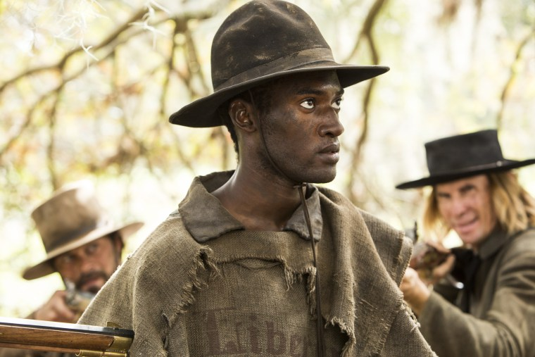 "Actor Malachi Kirby portrays Kunta Kinte in the History's miniseries remake of ""Roots."""