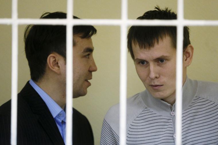 Image: Yevgeny Yerofeyev and Alexander Alexandrov attend a hearing on Sept. 29, 2015