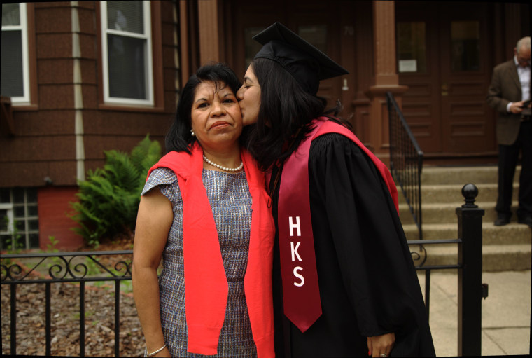 Norma Torres Mendoza, who is graduating from the prestigious Kennedy School of Government at Harvard University, kisses her mom, Carmen Torres in Cambridge, Mass., on May 24, 2016.  Mendoza and her mom celebrated at Harvard's 2nd Latino Graduation, a student-led event celebrating the achievements of Latino students.
