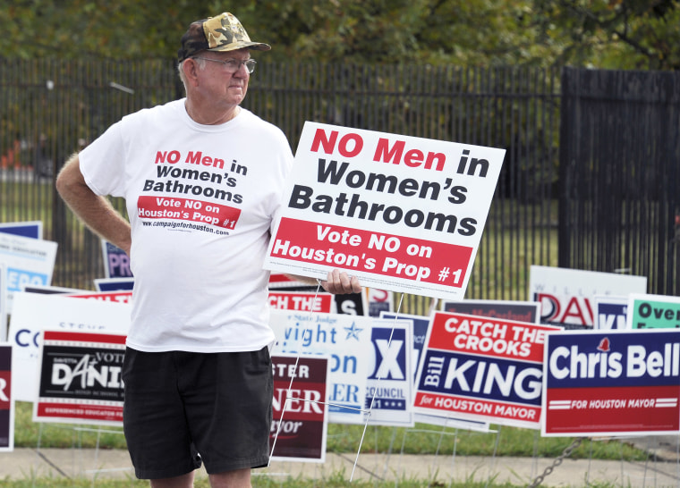 Image: A demonstrator holds a sign against the Houston Equal Rights Ordinance