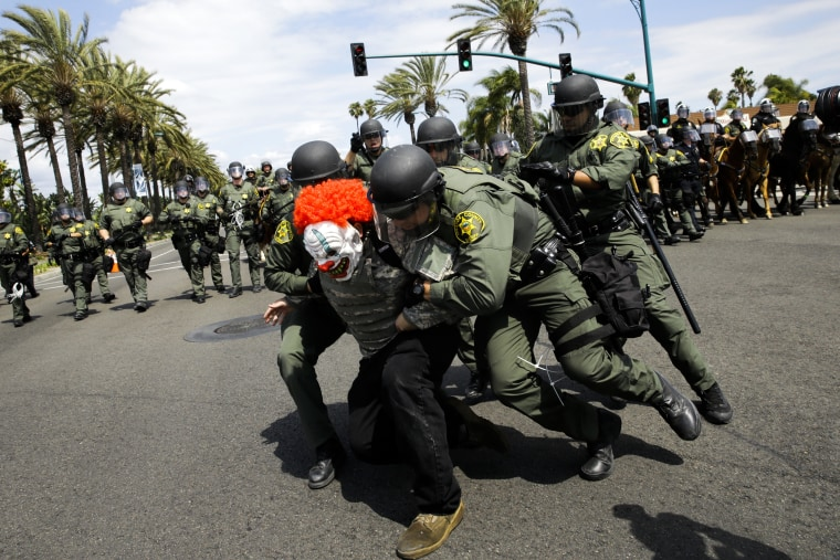 Orange County Sheriff's deputies take a protester into custody outside the Anaheim Convention Center where Republican presidential candidate Donald Trump held a rally, Wednesday, May 25, 2016, in Anaheim, Calif.