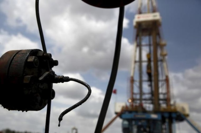 Crude oil drips from a valve at an oil well operated by Venezuela's state oil company PDVSA, in the oil rich Orinoco belt, near Morichal at the state of Monagas