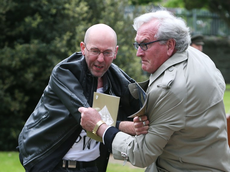 Image: Canadian Ambassador to Ireland Kevin Vickers wrestles with a protester