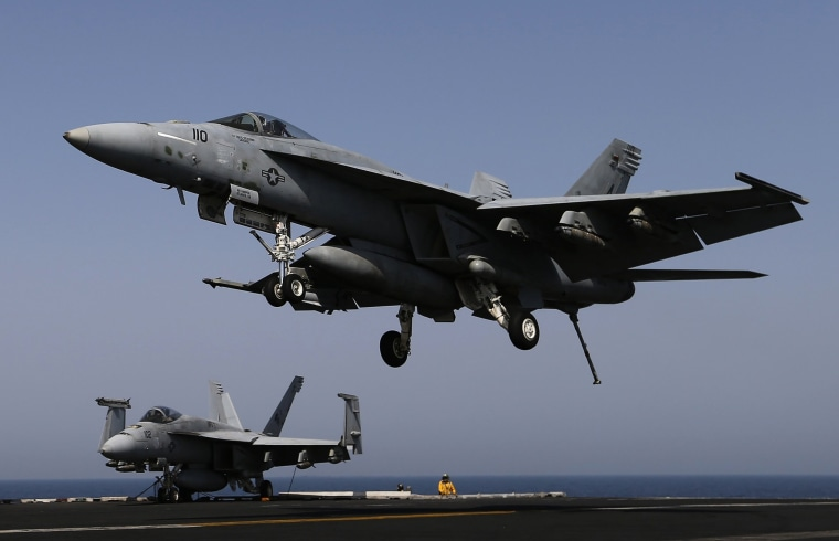 Image: A F/A-18E comes in to land onboard USS George H.W. Bush in the Persian Gulf