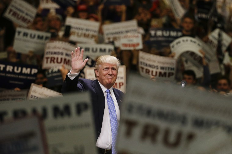 Image: Donald Trump waves to the crowd as he arrives at a rally