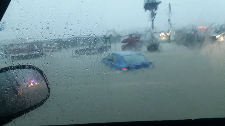 Cars are submerged in floodwaters along Highway 21 in Bryan, Texas, on May 26.
