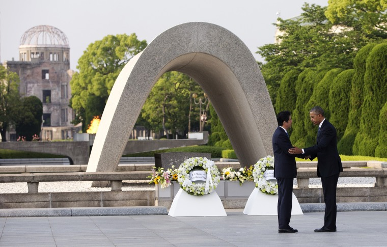 Image: Presidents Barack Obama and Shinzo Abe shake hands after laying wreaths at the cenotaph at Hiroshima Peace Memorial Park in Hiroshima
