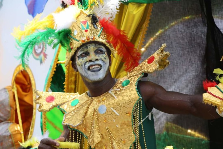 A masquerader dances through the streets of Guyana's capital city of Georgetown during the Golden Jubilee Float Parade.