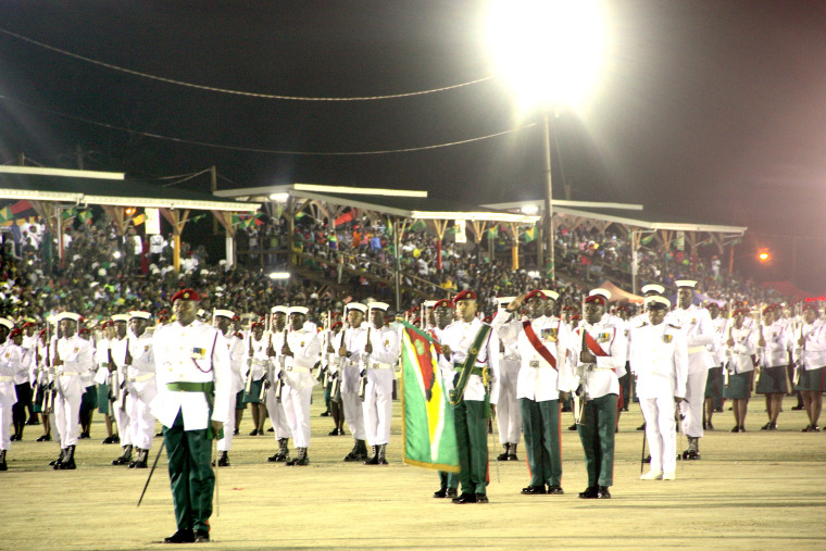 Members of Guyana's Defence Force take center stage at D'Urban Park in Georgetown during Guyana's 50th Anniversary of Independence Flag Raising Ceremony on May 25, 2016.