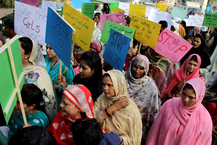 Pakistani women observe the International Day for the Elimination of Violence against Women, in Lahore, Pakistan, on Nov. 25, 2015.