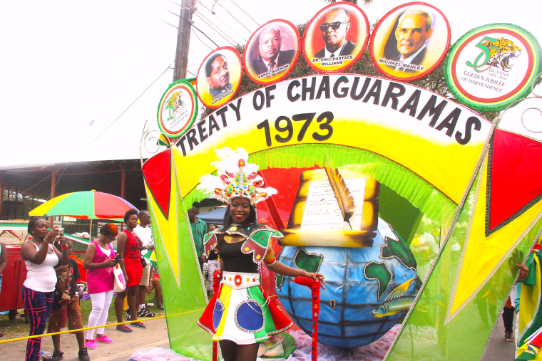 Guyanese songstress Lisa Punch parades through the streets in a costume that represents an important part of Guyana's history. Guyana was one of first four countries to sign the Treaty of Chaguaramas in 1973, which established the Caribbean Community and Common Market, known as CARICOM.