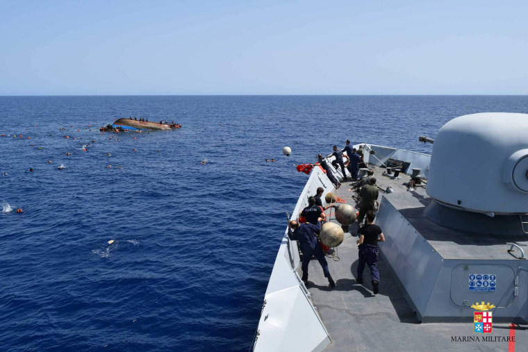 Image: TOPSHOT-ITALY-REFUGEE-IMMIGRATION-SHIPWRECK-RESCUE
