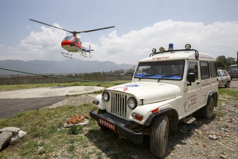Image: The body of climber Eric Arnold arrives in Kathmandu