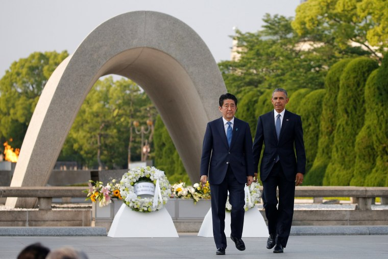 Image: U.S. President Barack Obama (R) and Japanese Prime Minister Shinzo Abe walk in front of a cenotaph after they laid wreaths at Hiroshima Peace Memorial Park in Hiroshima, Japan