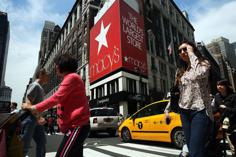 Image: Pedestrians walk by Macy's flagship store in Herald Square