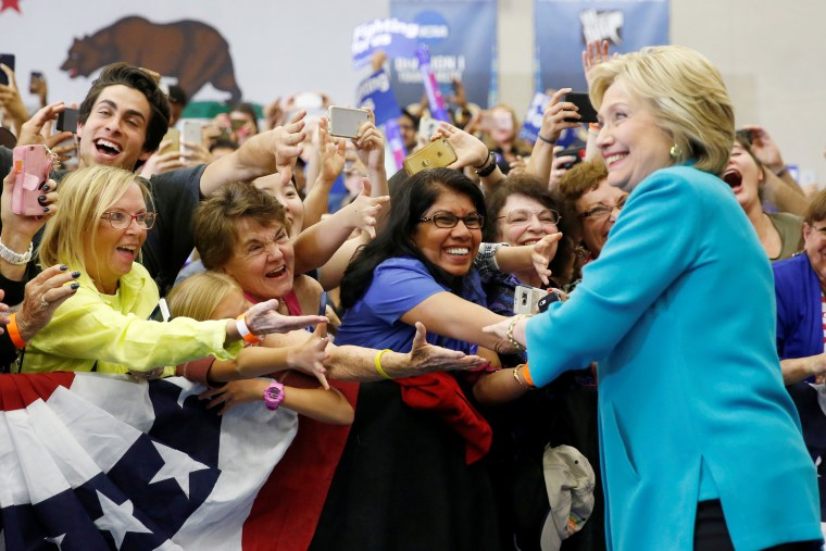 Image: Supporters greet U.S. Democratic presidential candidate Hillary Clinton as she arrives to speak at the University of California Riverside in Riverside