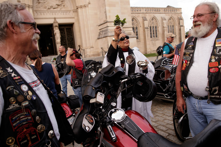 Image: Rev. Cassandra Burton blesses Rolling Thunder members and their motorcycles