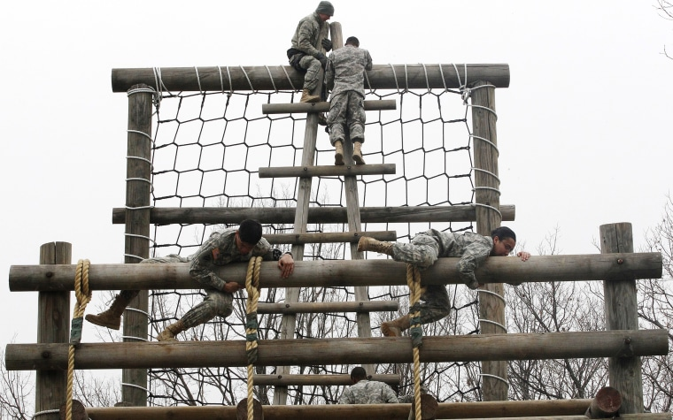 U.S. Army soldiers negotiate an obstacle structure during an Air Assault training course at a U.S. Army base in Dongducheon, South Korea, in 2013.