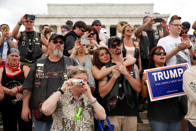Image: People watch Trump address the Rolling Thunder motorcycle rally to highlight POW-MIA issues on Memorial Day weekend in Washington