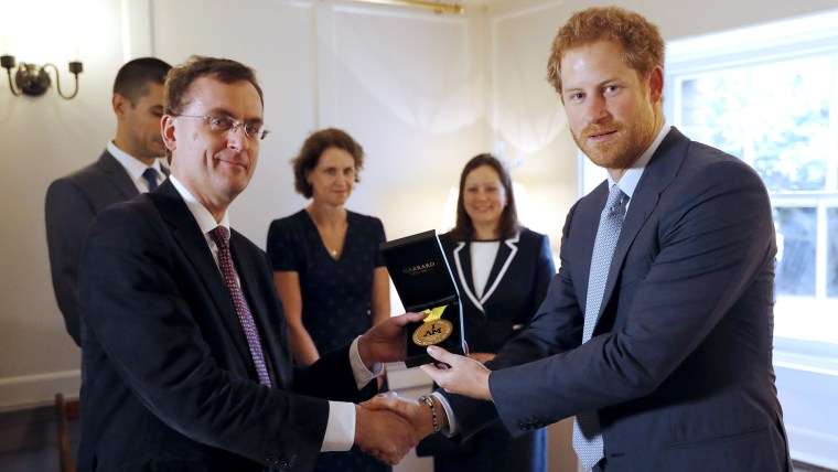 Prince Harry gives Invictus gold medal to Papworth Hospital staff