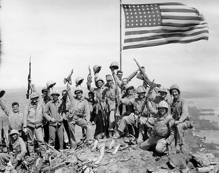 """Photo taken by Army Pfc. George Burns at the summit of Mount Suribachi is nearly identical to the so-called """"gung-ho"""" photo shot by the AP's Joe Rosenthal."""