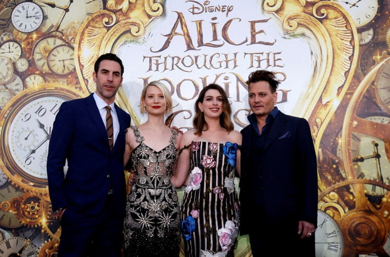 """Image: Cast members Cohen, Wasikowska, Hathaway and Depp pose at the premiere of """"Alice Through the Looking Glass"""" at El Capitan theatre in Hollywood"""