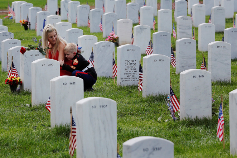 Mom embraces her son on Memorial Day at Arlington National Cemetery in Washington