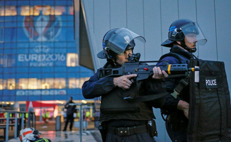 Image: French Police forces take part in a mock attack drill outside the Grand Stade stadium in Decines