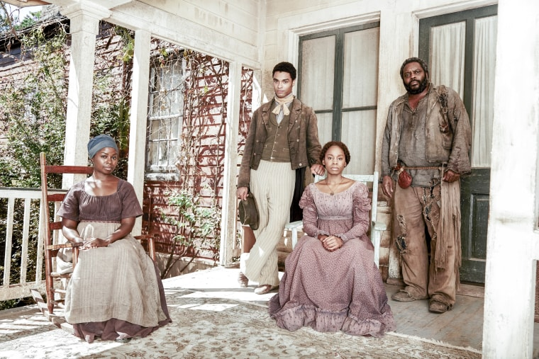 """Actress Erica Tazel as Matilda alongside cast on the HISTORY event series, """"Roots."""""""
