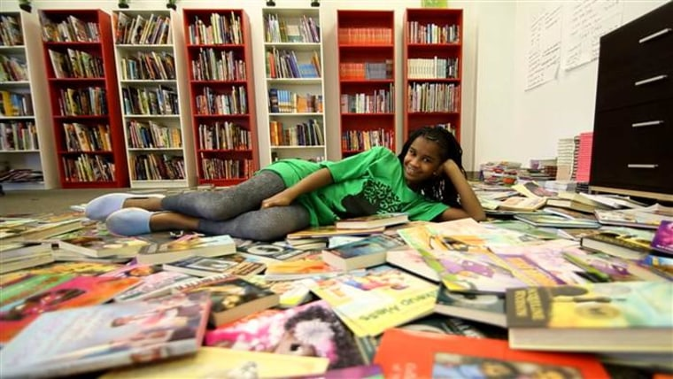 Marley Dias with some of the books she's collected for her #1000BlackGirlBooks campaign.
