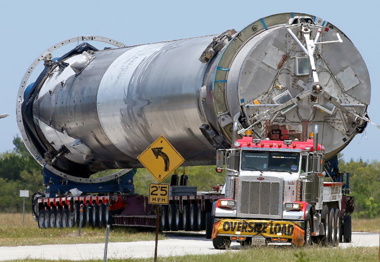 Image: The recovered first stage of a  SpaceX Falcon 9 rocket is transported to the SpaceX hangar at launch pad 39A at the Kennedy Space Center in Cape Canaveral