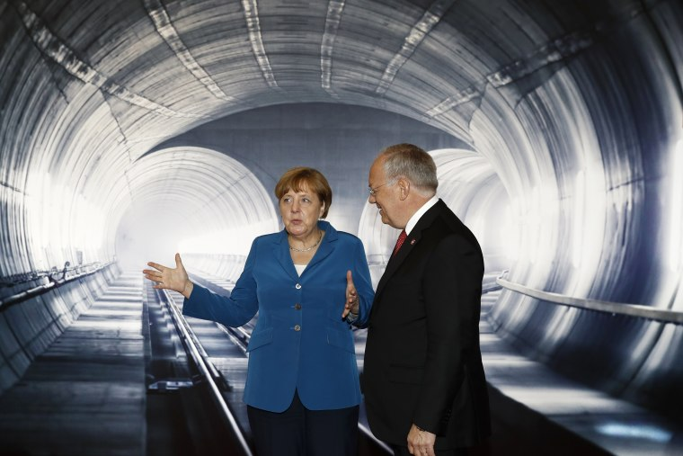 Image: Swiss Federal President Johann Schneider- Ammann and German Chancellor Angela Merkel were among the guests at the opening of the world's longest rail tunnel.
