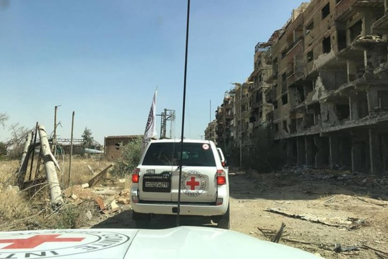 Image: The ICRC said aid trucks entered Daraya during Wednesday's ceasefire.