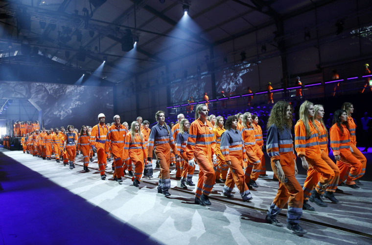 Image: Performers take part in show during opening ceremony of NEAT Gotthard Base Tunnel in Erstfeld