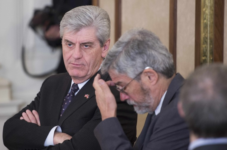 Mississippi Governor Phil Bryant (L) looks on during a meeting of the National Governors Association at the White House in Washington, DC, February 23, 2015.