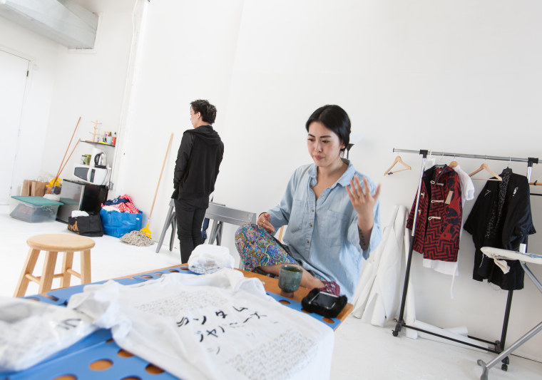 Kevin Wang, left, and Sasa Li, right, discuss cultural appropriation in Li's Brooklyn studio.