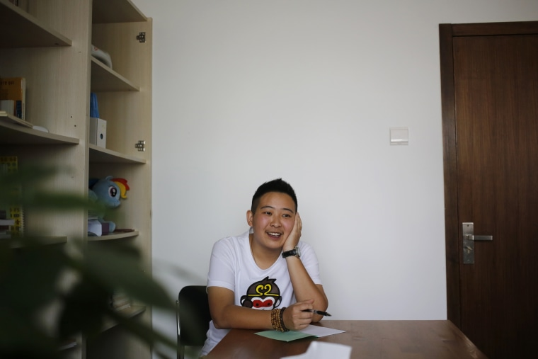 "A transgender equal rights supporter who goes by the name of ""Mr. C"" pauses during an interview in Beijing on May 18, 2016. The 28-year-old transgender man, who keeps his real name secret to protect his parents' privacy, has become the public face of the fight for job equality in China, where sexual and gender minorities are only beginning to emerge from virtual invisibility."