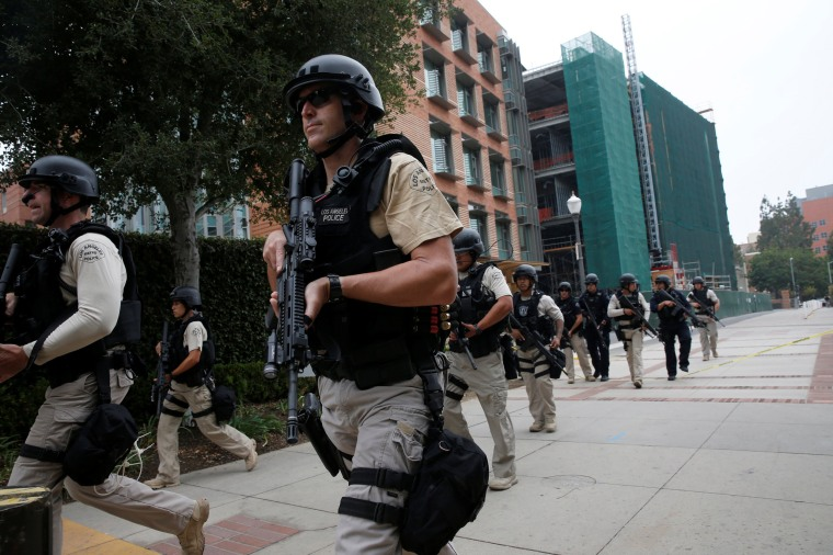 Image: A Los Angeles Metro Police squad conducts a search on the University of California, Los Angeles campus after it was placed on lockdown following reports of a shooter on the campus in Los Angeles