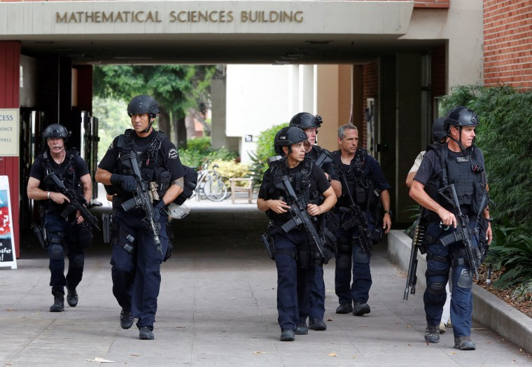 Image: Police officers conduct a search at the UCLA campus after it was placed on lockdown following reports of a shooter that left 2 people dead in Los Angeles, California