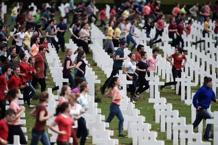 Image: French and German youths take part in a show at the French National cemetery
