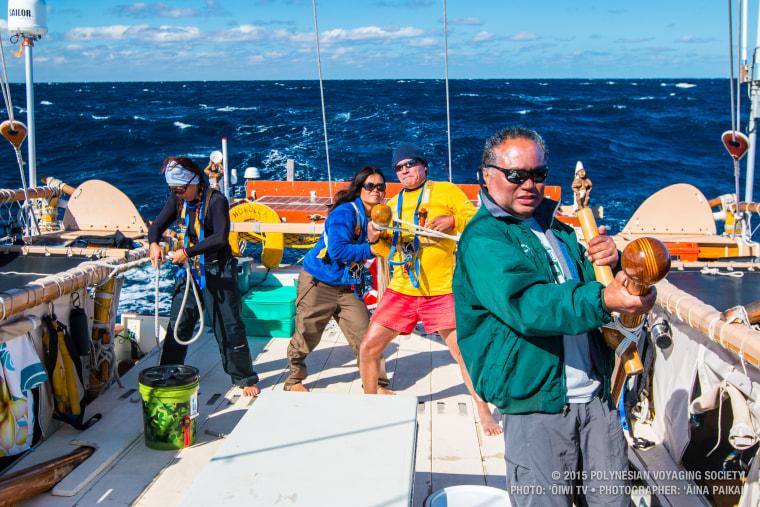Volunteer Hokulea crew members navigating the ocean during the 2015 leg of the craft's three-year voyage