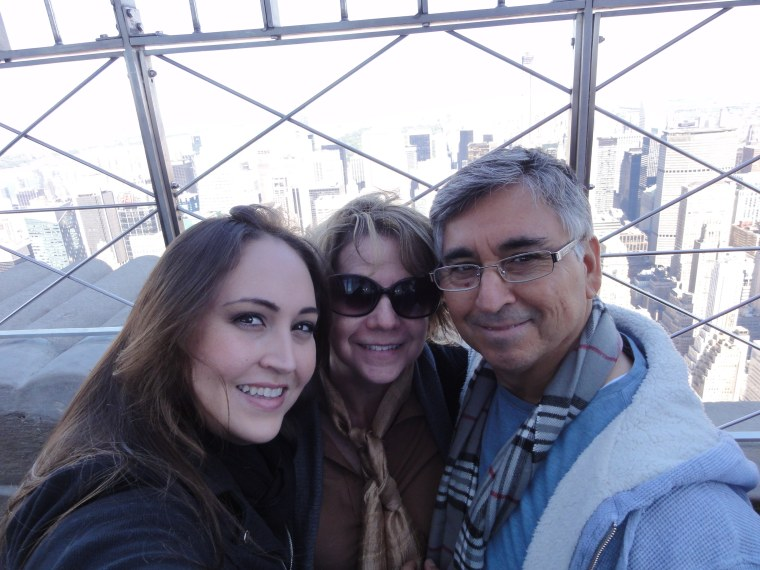 Linda and Sixto Valdez raised their daughter, Lucy, to be bilingual and to honor both of their cultures. Here, they are photographed at the Empire State Building in New York.