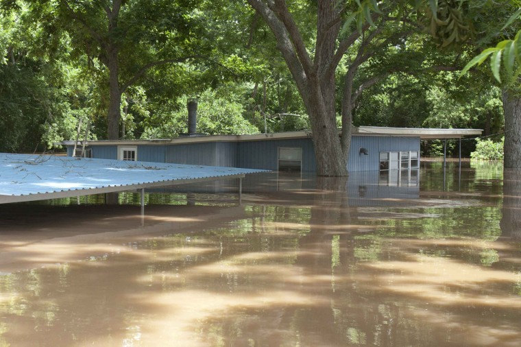 Image: A house is flooded by water from the rain-swollen Brazos River in Richmond, Texas