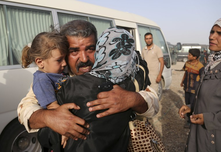 Image: A soldier is reunited with his family
