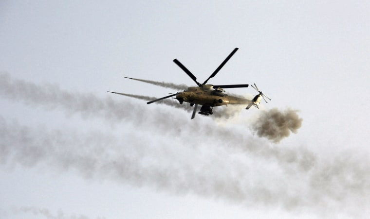 Image: A helicopter fires weapons during clashes with Islamic State militants in Saqlawiya