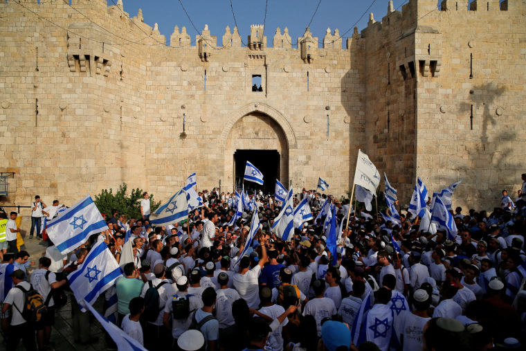 Israelis carry flags during a march marking Jerusalem Day, the anniversary of Israel's capture of East Jerusalem during the 1967 Middle East war, just outside the Damascus Gate of Jerusalem's Old City on June 5.