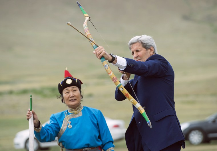 Secretary of State John Kerry shoots a bow and arrow as he participates in a Naadam ceremony, a competition which traditionally includes horse racing, Mongolian wrestling and archery, in Ulan Bator, Mongolia on June 5. Kerry arrived in Mongolia on June 5, the latest senior U.S. official to make the trip to the mineral-rich country neighbored by Russia and China.