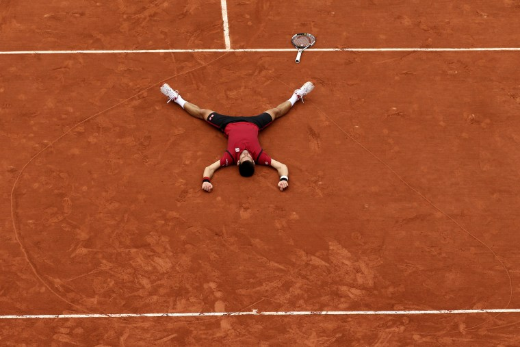 Serbia's Novak Djokovic lays on the clay in a heart he etched on the court after defeating Britain's Andy Murray in the French Open final on June 5 at the Roland Garros stadium in Paris.